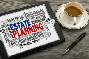 estate planning concept with related word cloud on tablet pc